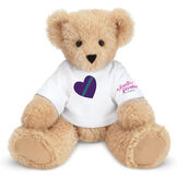 "15"" Spark Kindness Bear - Front view of seated soft caramel brown bear dressed in a white t-shirt with blue and purple heart graphic on front and ""The Jennifer Riordan Foundation"" on right sleeve in pink image number 0"