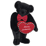"""15"""" Happy Anniversary Bear - Front view of standing jointed bear dressed in a red velvet bow tie and holding a red heart pillow that says' Happy Anniversary"""" in white  - Black fur image number 3"""