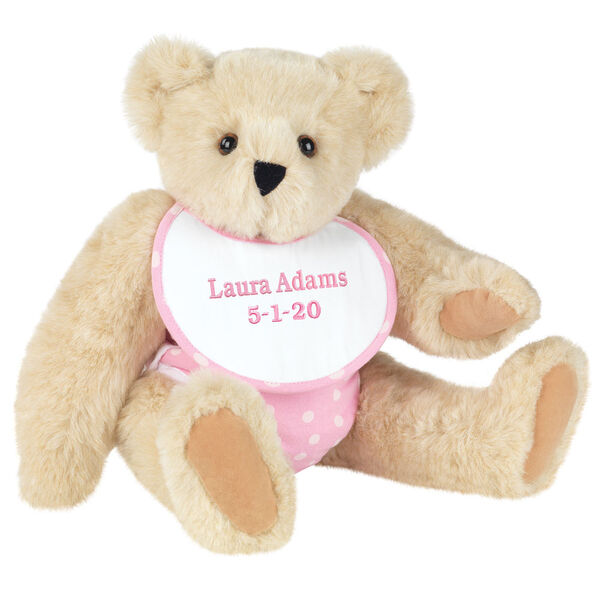 "15"" Baby Girl Bear - Seated jointed bear dressed in pink with white dots fabric diaper and bib. Bib with ""Laura Adams"" and ""5-1-20"" in light pink lettering - Buttercream brown fur image number 1"