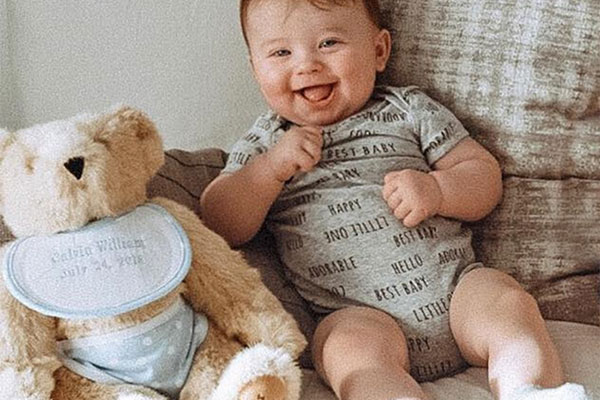 An image of an infant with the 15-inch Baby Boy Bear