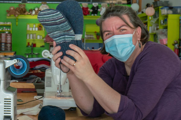 An image Jen Ellis - creator of the famous Bernie Mittens - making mittens at our facory in Shelburne, Vt