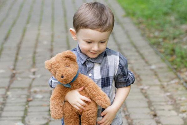 An image of a boy cuddling 5 15-inch Buddy bear Bears