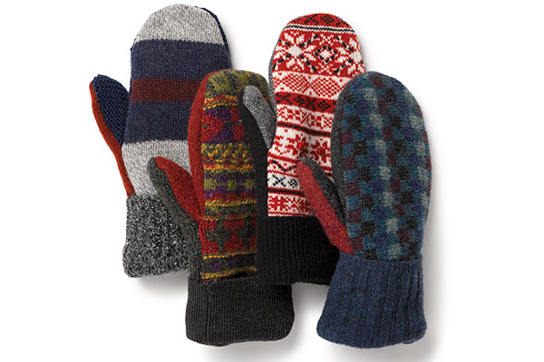 An image of 4 unique pairs of Vermont Mitten Company mittens in various colors and patterns