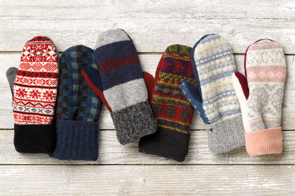 An image of 6 unique pairs of Vermont Mitten Company mittens in various colors and patterns