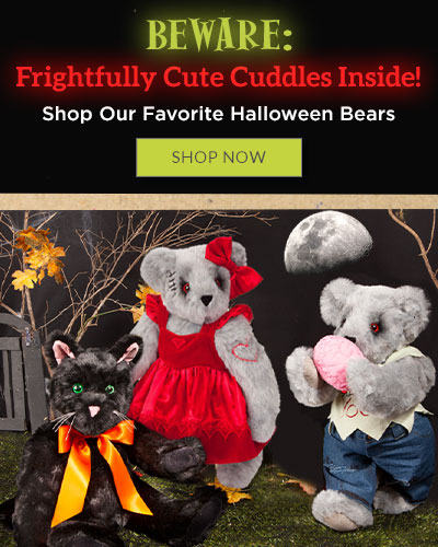 A photo of the 15-inch Black Cat, 15-inch Zombie Sweetheart Bear and the 15-inch Zombie Love Bear standing in a grave yard at night