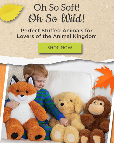 An image of a child sitting on a couch with the 18-inch Oh So Soft Fox, Puppy and Monkey