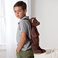 An image of a young boy wearing the 19-inch Teddy Bear Backpack
