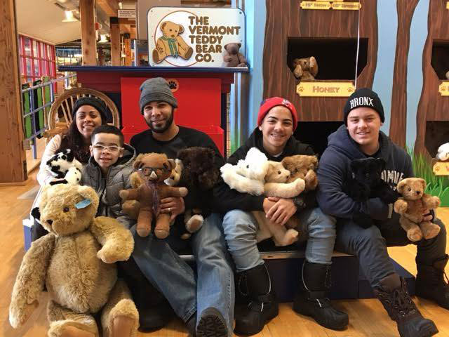 A group of people sitting with teddy bears