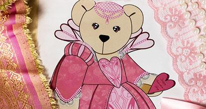 A close up image of a princess prototype teddy bear