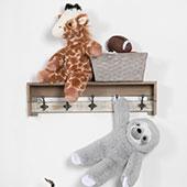 The 18-inch Sloth and Giraffe teddy bears playing on a bookshelf