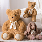 The 20-inch and 3-foot World's Softest Bears sitting in a room with the 20-inch World's Softest Bunny