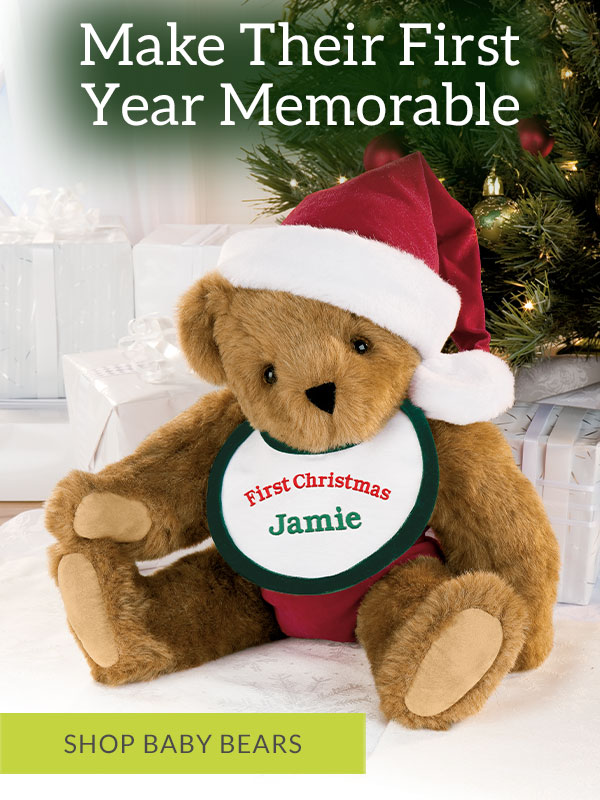 An image of the Vermont Teddy Bear 15-inch Baby's First Christmas Bear in a Christmas Scene