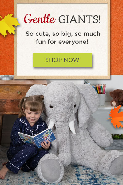 An image of a girl reading a book to a 4-foot Cuddle Elephant stuffed animal