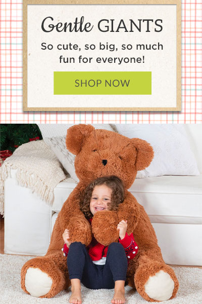 An image of a girl being hugged by the 4-foot Brown cuddle bear