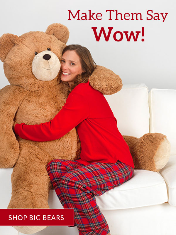 An image of the Vermont Teddy Bear 4-foot Big Hunka Love Bear with a model