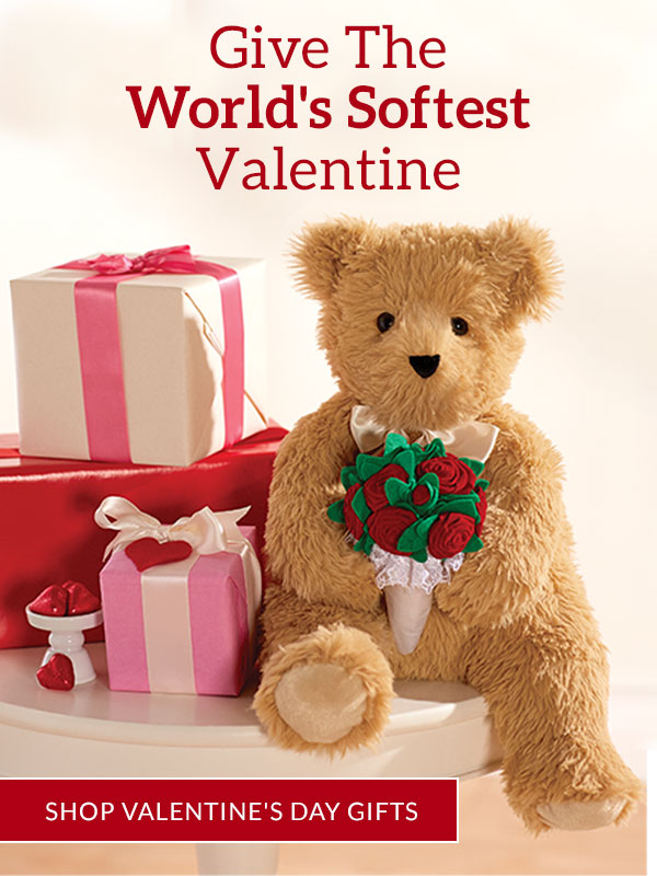 An image of the Vermont Teddy Bear 20-inch World's Softest Bear holding a red rose bouquet