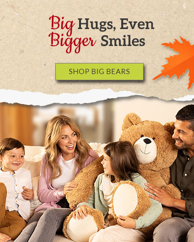 An image of the a Mother, Father, Daughter and Son sitting on a couch with a 4-foot Big Hunka Love Bear