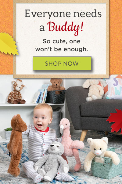 An image of a child holding the 15-inch Buddy Bear surrounded by the 15-inch Buddy Flamingo, 15-inch Buddy Sloth and 15-inch Buddy Kitten