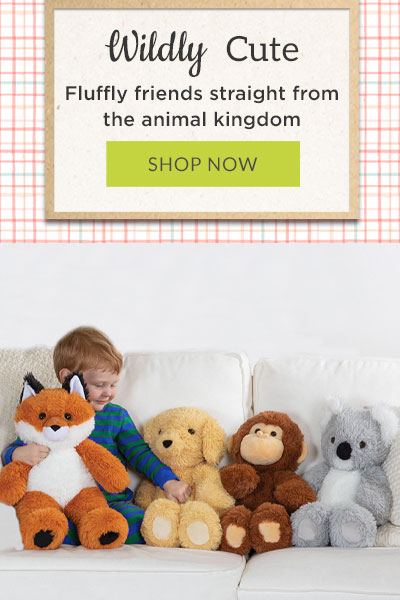 An image of a boy playing with the 13-inch Cuddle Cub Collection